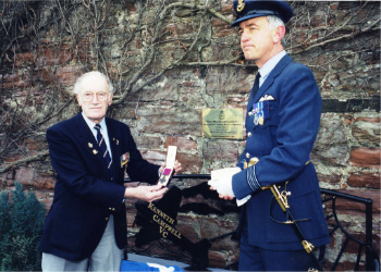 Dedication of the Kenneth Campbell Memorial Garden in 2000, with Ron Bramley who flew with Kenneth on the 1941 raid and Wing Commander David Simpson of 22 Squadron; displaying Kenneth's VC which was gifted to the Squadron.