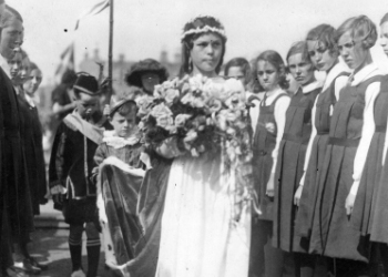 Annie Harper, Queen of the Sea 1933. Miss Annie Harper, en route to her crowning passing pupils from Kyleshill School. The pageant was inaugurated by the Town Council as part of the celebrations to mark the Quater Centenary (1528-1928) of the forming of Saltcoats into a Burgh of Barony.